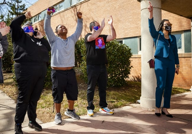 Supporters of death row inmate Julius Jones react to Monday's vote of the Pardon and Parole Board while stading outside the Parole Board's building. The board voted to seek further review of Jones' case. [Chris Landsberger/The Oklahoman]