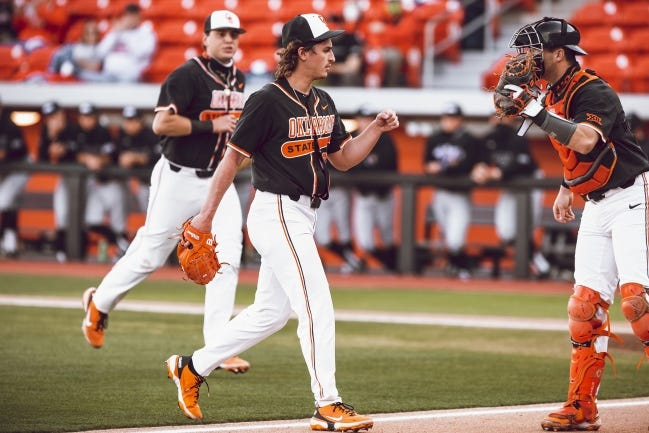 Oklahoma State lefty Justin Wrobleski (32) celebrates after an out Saturday in a 3-0 win against Grand Caynton in Stillwater. [BRUCE WATERFIELD/OSU ATHLETICS]