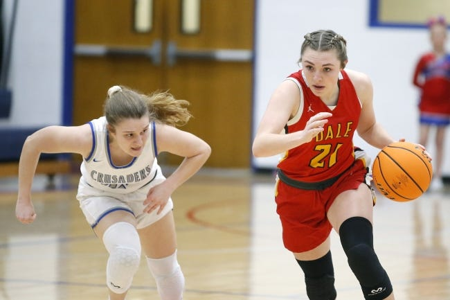 Dale's Danyn Lang goes past Christian Heritage Academy's Haylee Witcher during a game on Feb. 2. [Bryan Terry/The Oklahoman]