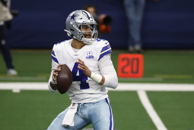 Dallas Cowboys quarterback Dak Prescott drops back to pass in a game against the Cleveland Browns. Prescott and the Cowboys agreed to a 4-year, $160 million deal, ESPN's Adam Schefter tweeted on Monday. [AP Photo/Ron Jenkins, File]