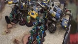 Watch a few moments as Warhammer teams compete in Highland Twp Library tourney. 68 players from all over competed in using elaborately painted pieces.