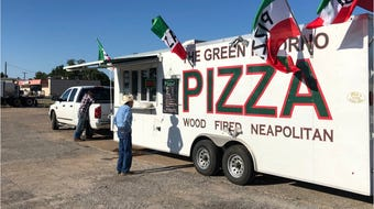 """Seymour coach Hugh Farmer has turned a hobby of cooking pizzas into a side business with his food truck """"The Green Inforno."""""""