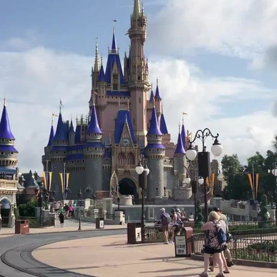 Disney debuts matching pixie dust masks for theme park employees