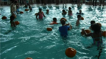 A few moments above and below water at Canton's Pumpkin Patch in the Pool party