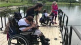 The agency held its 15th annual fishing derby Wednesday to help people with disabilities get out into the community.