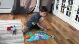 Johnny Piet, 7, sets up his Pokemon game board. Piet earned enough points in local competitions to earn his way to a national championship.