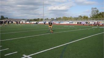 South Lyon High football kicker William Stoyanovich practices field goals