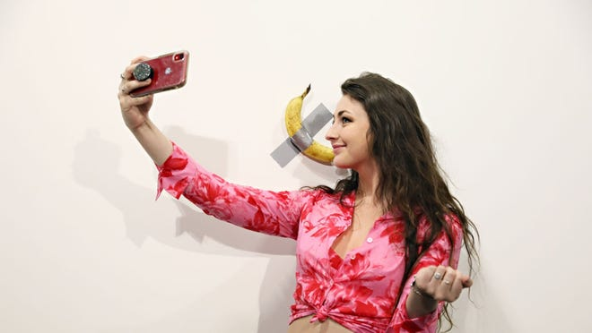 A man ate $120,000 duct-taped banana art: 'I really love this installation. It's very delicious'