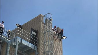 Reporter rappels down building at FDL Fire/Rescue training
