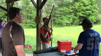 Members of Sullivan's Sharpshooters practice target shooting with .22-caliber rifles at the Chemung County Rod & Gun Club in Breesport.