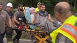Crews in Stanton, Kentucky were called to a home that was smashed by a mudslide amid heavy rains and were able to rescue a 90-year-old woman from the debris. (June 18)