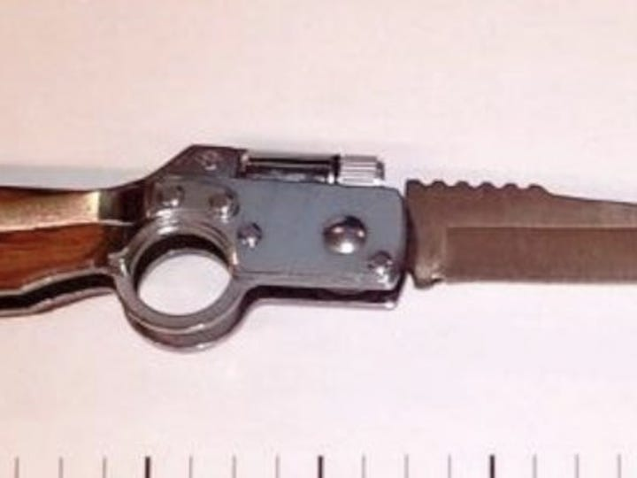 TSA agents may have been confused as how to classify this weapon when a passenger tried to bring a knife-shaped gun through airport security.