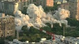 Aerial video captured clouds of smoke and dust as a Republic/National Bank facility was imploded in Dallas Sunday morning. (Sept. 16)