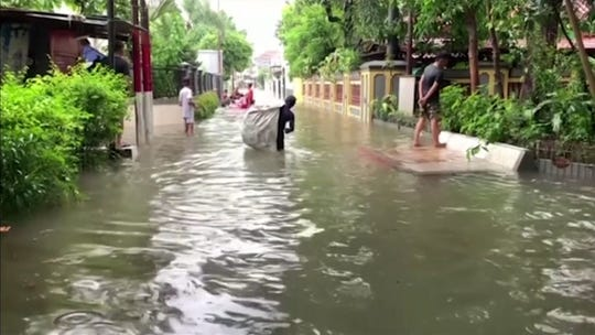 Thousands caught in floods in Jakarta, Indonesia's sinking capital