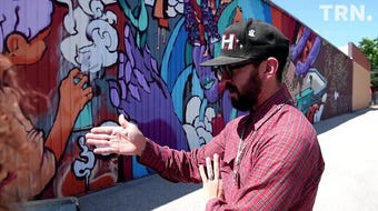 Mural artist Joerael Numina is creating a large, Texas-themed mural for the side of Deviance Skate Supply.