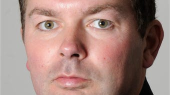 A Knoxville police officer is asking a judge to overturn his demotion, saying he was singled out for having a sexual relationship with a coworker.