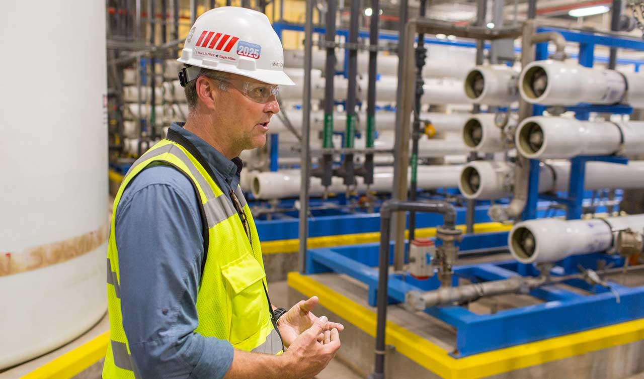 Matt Johnson, external affairs manager at Eagle Mine, explains systems and processes at the mine's water treatment facility in Marquette County, Michigan.