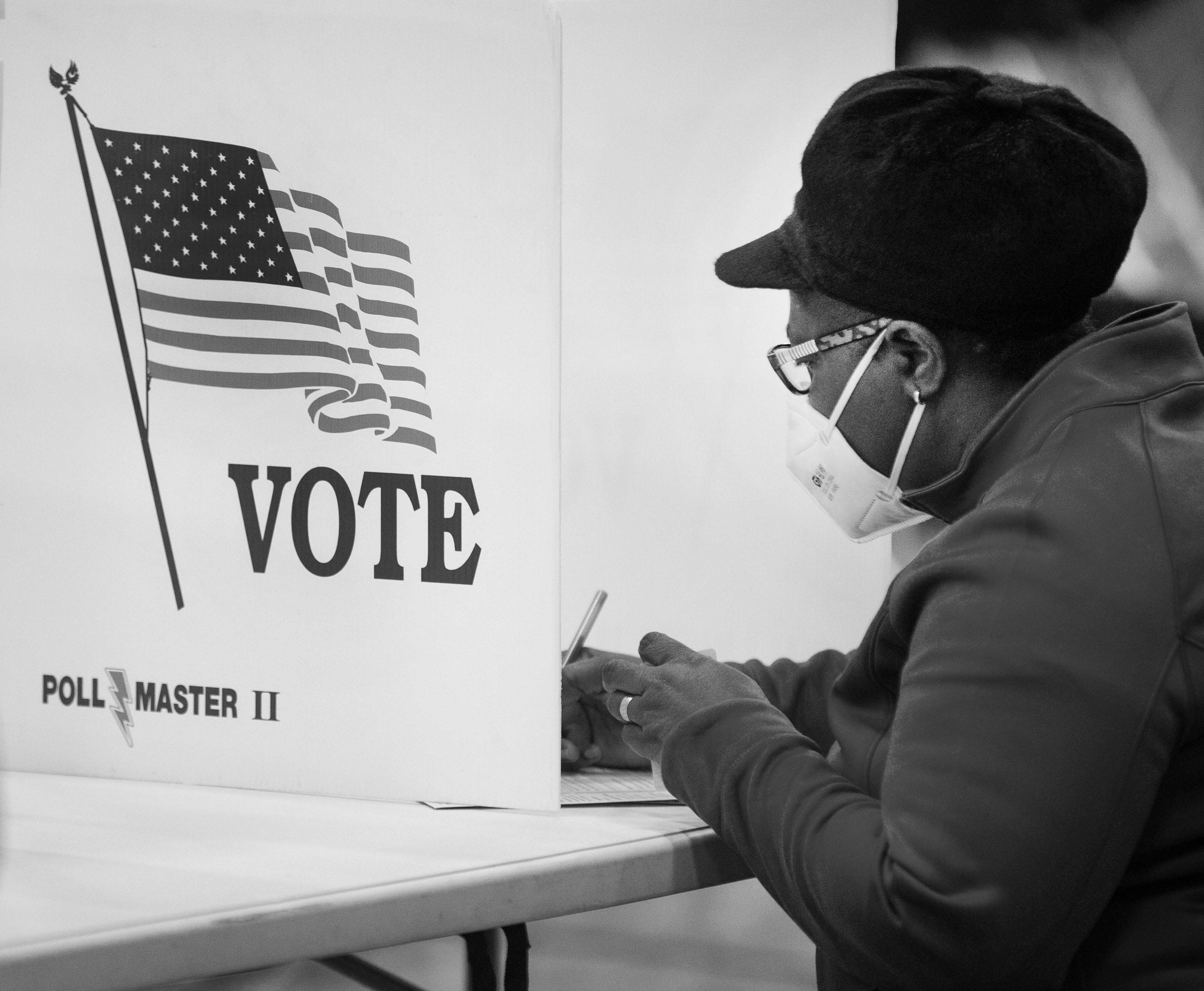 A woman votes at Creekside Elementary in Fairfield, Ohio, on Election Day