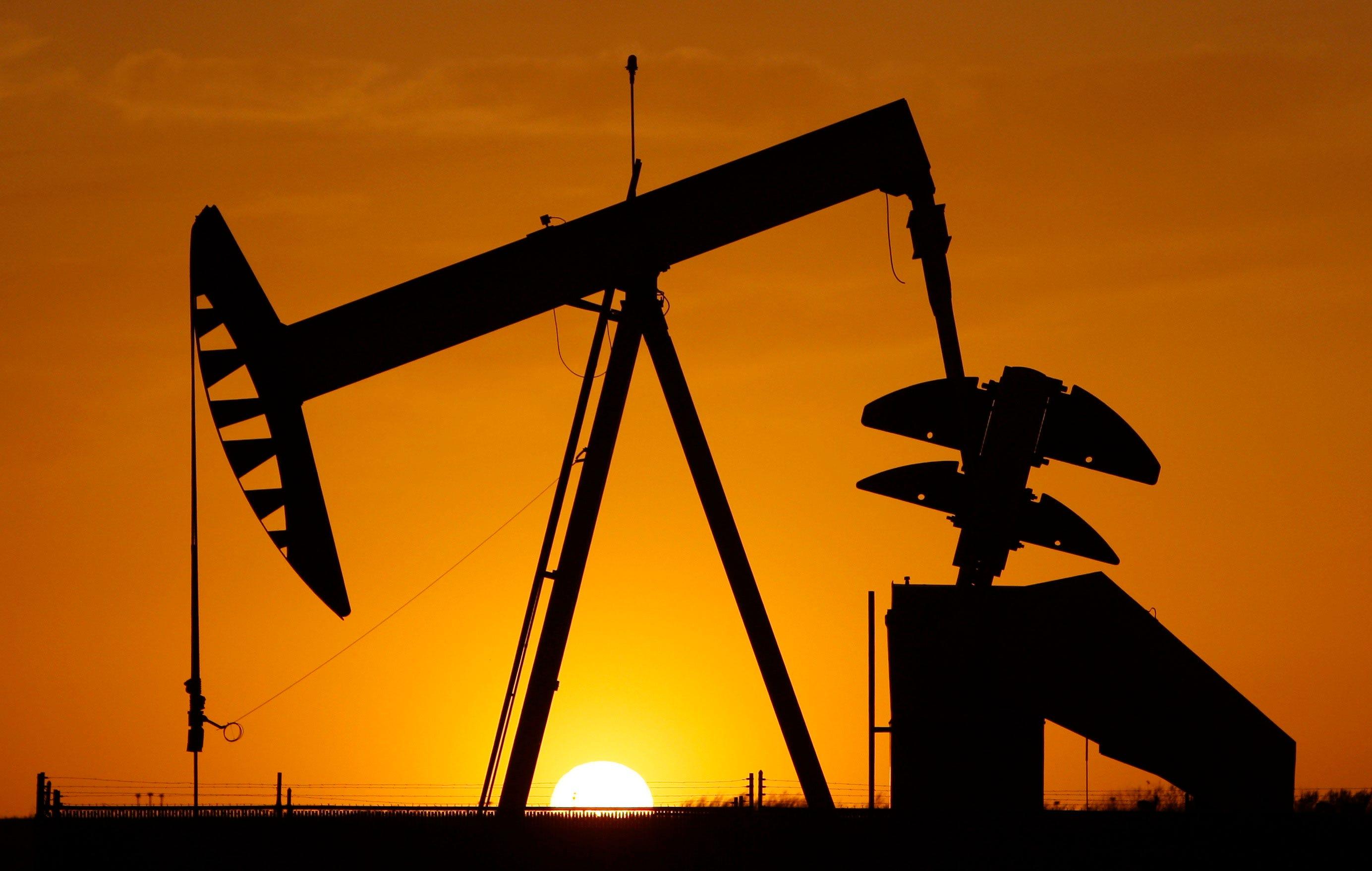 Crude oil dips below $60 a barrel
