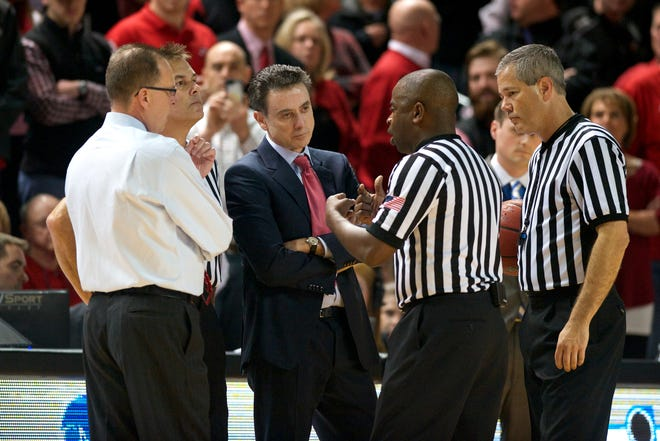 Dec 20, 2014; Bowling Green, KY, USA; Western Kentucky Hilltoppers head coach Ray Harper (far left) and Louisville Cardinals head coach Rick Pitino (middle) talk to the referees during the first half at E.A. Diddle Arena. Mandatory Credit: Joshua Lindsey-USA TODAY Sports