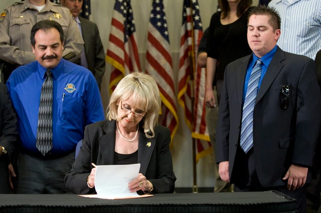 In April 2010, Gov. Jan Brewer signed into law Arizona's tough immigration measure, Senate Bill 1070, in one of – if not the – defining moments of her political career.