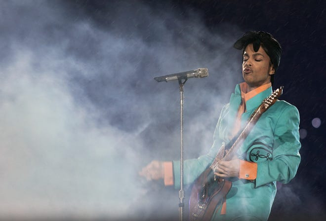 Super Bowl XLI: Prince performs during halftime of Super Bowl XLI at Dolphin Stadium in Miami between the Chicago Bears and the Indianapolis Colts.