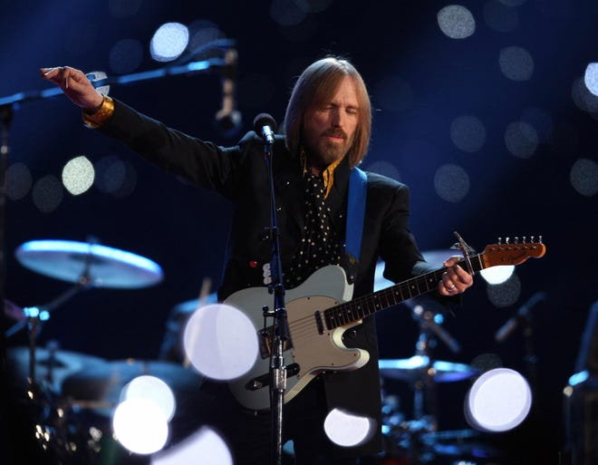 Tom Petty and the Heartbreakers perform during the halftime show at Super Bowl XLII at the University of Phoenix Stadium in Glendale, Ariz.