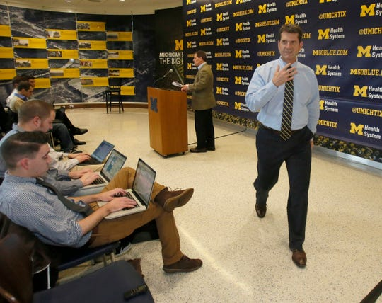 Michigan coach Jim Harbow is leaving after finishing his first press conference for the signing day in Michigan at Schembechler Hall on Wednesday, February 4, 2015.