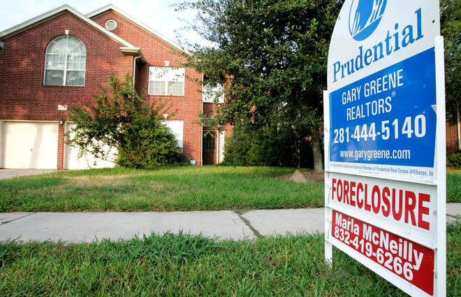 A foreclosure home for sale is shown Tuesday, Aug. 22, 2006.