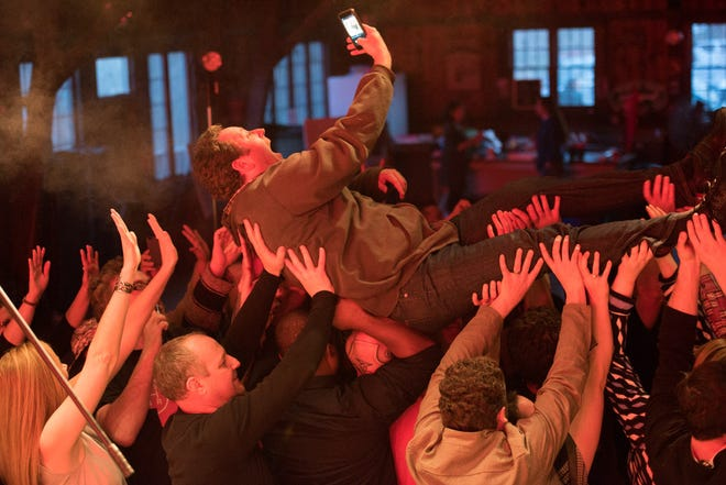 Entertainment reporter Ryan Cormier crowd surfs during a News Journal photo shoot in Arden last week.