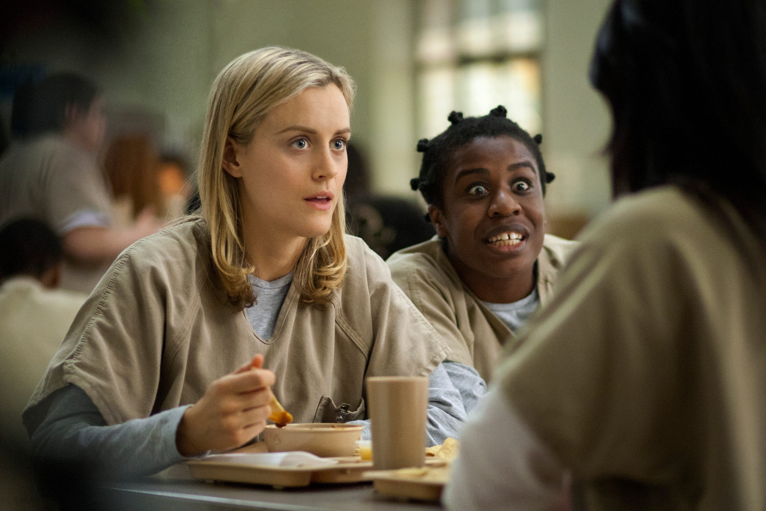 """Taylor Schilling, left, and Uzo Aduba in a scene from """"Orange is the New Black."""""""