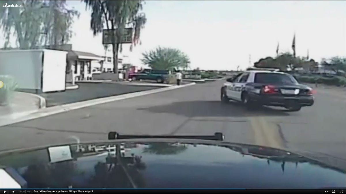Raw: Video shows Ariz  police car hitting robbery suspect