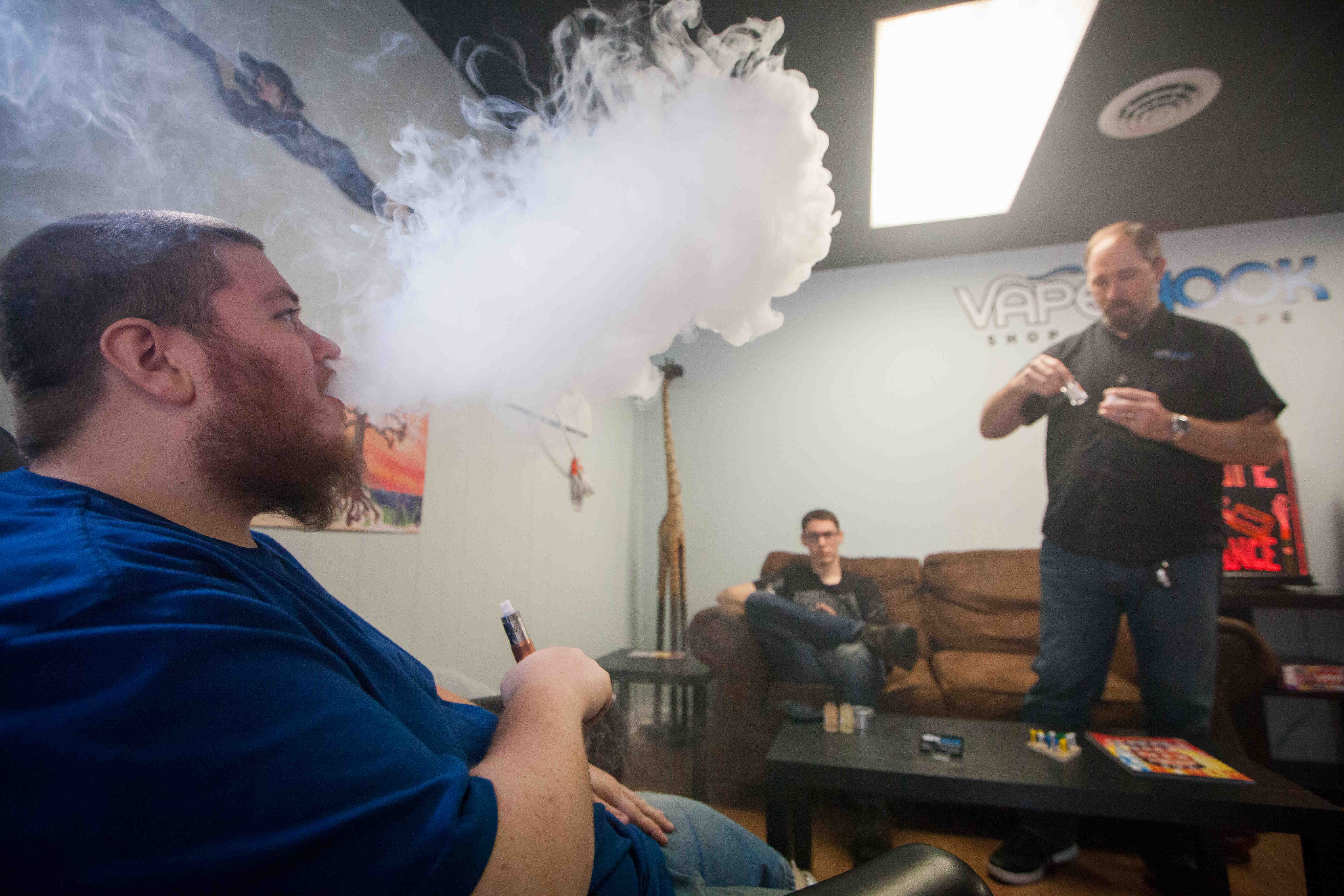 Vape shop owners, customers fight indoor ban on e cigs