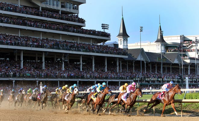 The field of horses come around the first turn of the 141st Kentucky Derby. Special to the Courier-Journal. Photo By Bud Kraft