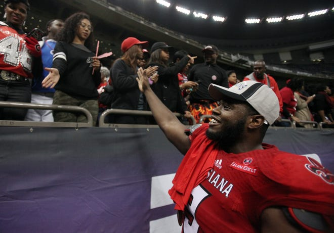 Ex-Cajuns defensive lineman Christian Ringo, now with the Green Bay Packers, celebrates with fans after UL's 16-3 win over Nevada in the 2014 New Orleans Bowl.