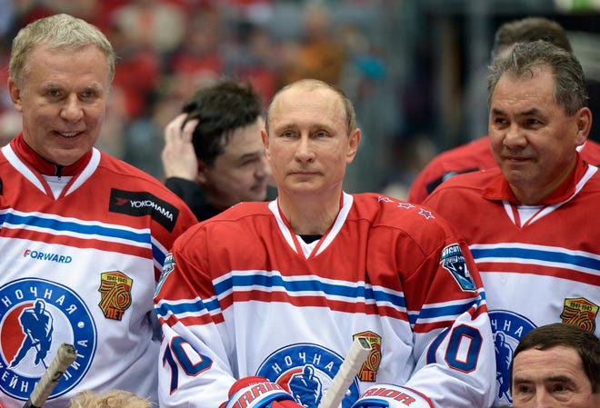 Russia Chairman of the Federation Council's Commission on sports Viacheslav Fetisov, left, and Russian President Vladimir Putin pose for a photograph in Sochi, Russia, on Saturday, May 16, 2015.