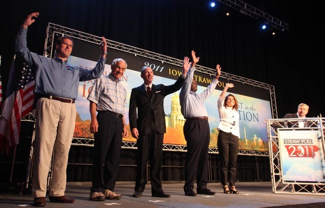 Republican presidential candidates, from left, former Pennsylvania Sen. Rick Santorum; former Minnesota Governor Tim Pawlenty; Rep. Ron Paul, R-Texas; Rep. Thaddeus McCotter, R-Mich.; businessman Herman Cain; Rep. Michele Bachmann, R-Minn. pose for a group photo at the Republican Party's Straw Poll in Ames, Iowa, Saturday, Aug. 13, 2011.