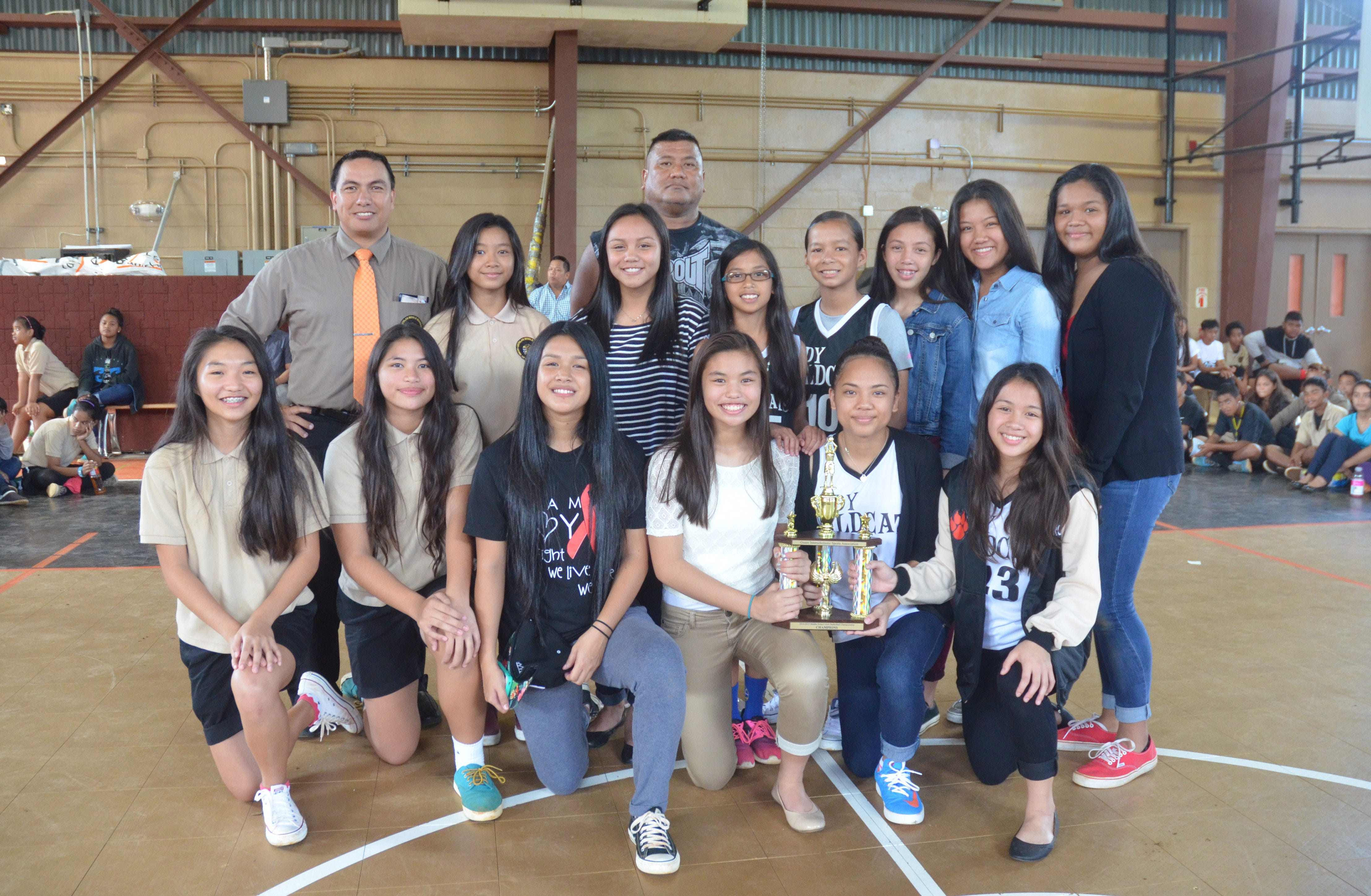 The Untalan Middle School Wildcats were presented with a trophy for winning the Guam Interscholastic Sports Association Girls' Basketball League championship in their gym on Friday, June 5, 2015. The Warriors were co-champions with the Benavente Middle School Roadrunners. Untalan won eight total championships during the 2014-2015 school year, including all six girls' sports, and were the GISA overall champions. The girls' A basketball team roster included, front from left, Eunchae Kim, Kirsten Santos, T'anna Dela Cruz, Taylor Aguon, Isla Quinata, Bila Aguon, second row from left, principal Jim Reyes, Jamie Mejia, Janisha Santos, Alana Salas, Aubri Chargualaf, Kiara Pangelinan, Mikayla Castro, Breani San Nicolas and, back, coach Ken San Nicolas.