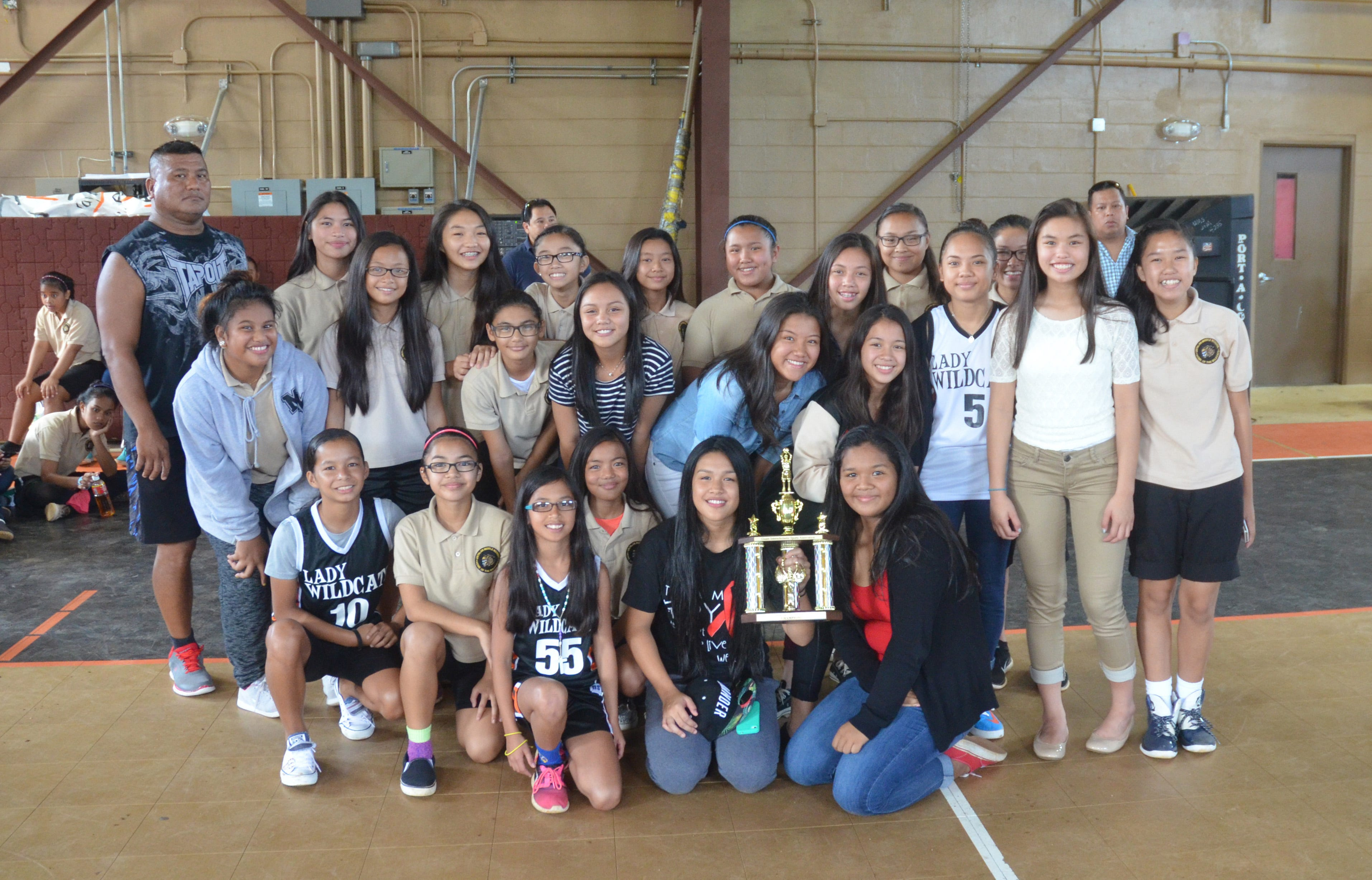 The Untalan Middle School Wildcats were presented with a trophy for winning the Guam Interscholastic Sports Association Girls' Basketball League championship in their gym on Friday, June 5, 2015. The Warriors were co-champions with the Benavente Middle School Roadrunners. Untalan won eight total championships during the 2014-2015 school year, including all six girls' sports, and were the GISA overall champions.Grant Wieman/Pacific Daily News/gwieman@guampdn.com