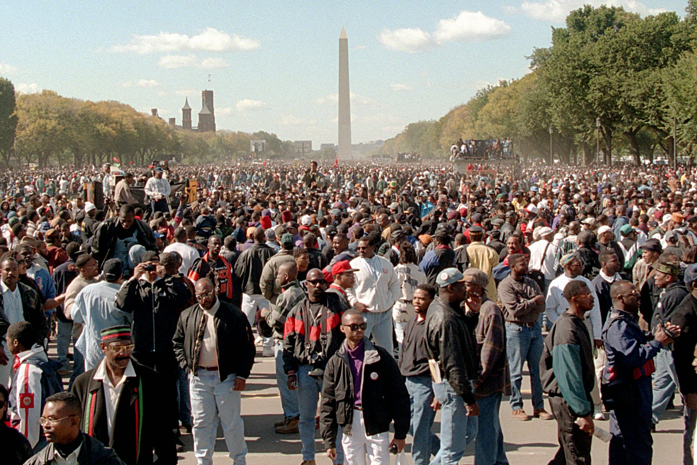 """The Million Man March was controversial and divisive at the time.Some didn't want to be associated with the Nation of Islamor itsleader, Louis Farrakhan. Others saw the stated purpose—""""ADayof Atonement""""—as an acceptance of guilt by Black men for conditions that are a legacy of slavery, discrimination and white supremacy.But the idea of uniting inadeclaration of African American pain, power andhumanity still drew hundreds of thousands to the National Mall."""