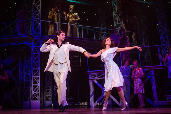 Tony (Sam Edgerly) and Stephanie (Jessica Lea Patty) have a stunning finish at the dance contest in the Finger Lakes Musical Theatre Festival's production of Saturday Night Fever through Aug. 12 at the Merry-Go-Round Playhouse.