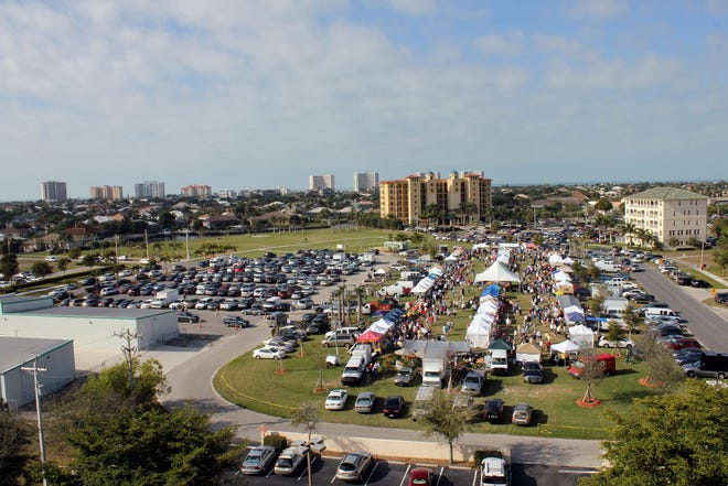 A typical Farmers' Market day at Veterans' Community Park on Marco Island shows the throngs of people who enjoy nosing around the stalls looking for produce, food and novelties.