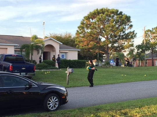 Investigators at the Derossett home.