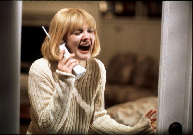 """Drew Barrymore in the iconic opening scene of Wes Craven's 1996 horror comedy """"Scream."""""""