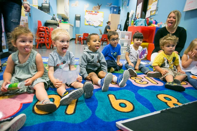 Children imitate their teacher at the Southwest Autism Research and Resource Center Community School in 2014.