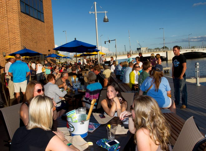 People dine out at the Ground Round at River's Edge on the night of the grand opening of the Oshkosh Riverwalk August 7, 2013.