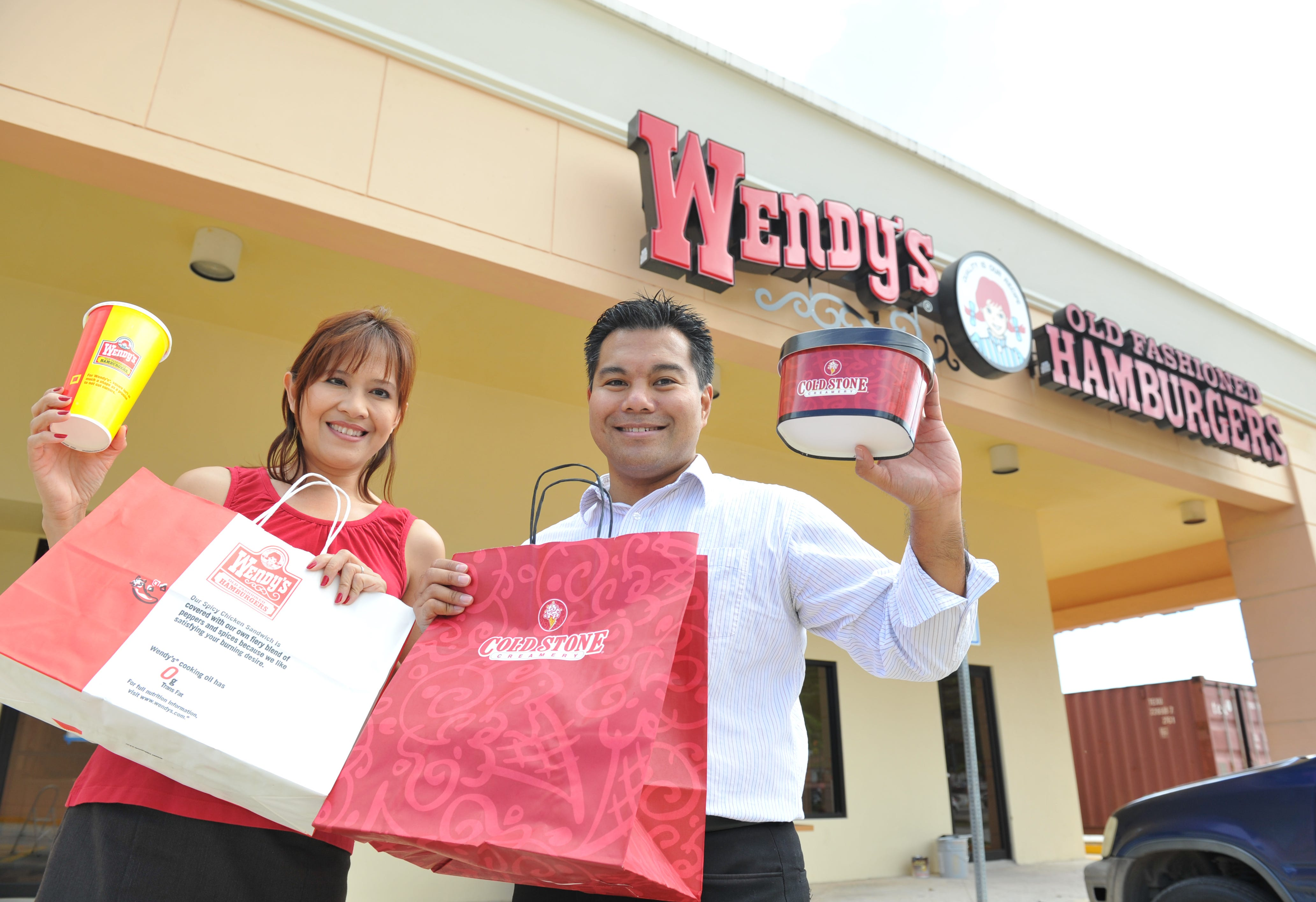 Jun and Sumiko Espaldon are photographed outside the Wendy's at Agana Shopping Center.