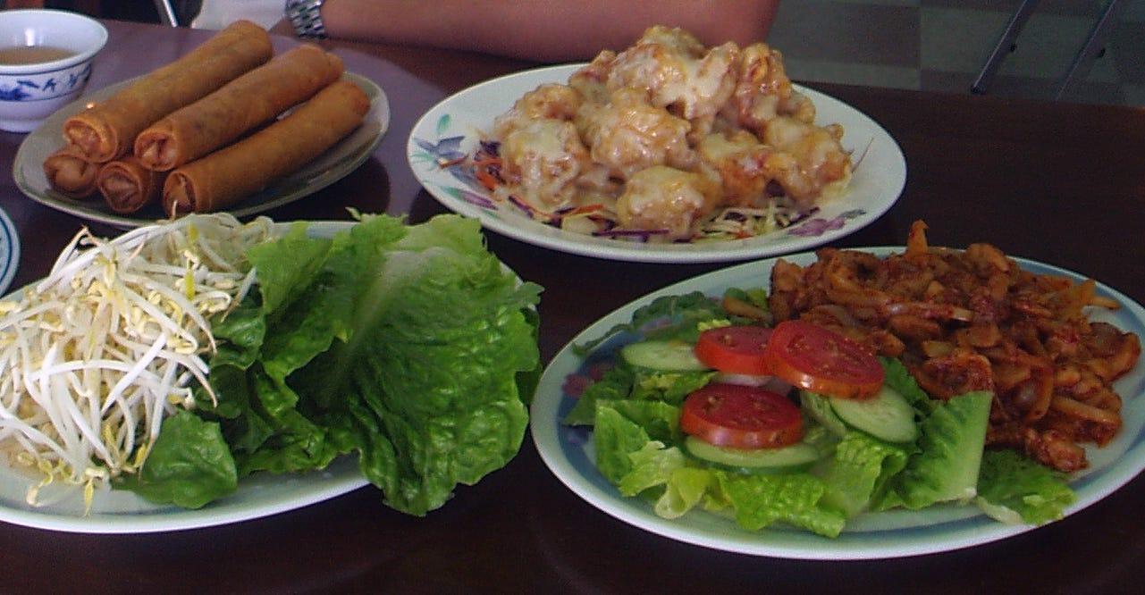 Fried lumpia, chicken lemongrass and honey walnut shrimp from Hoa Mai VI.