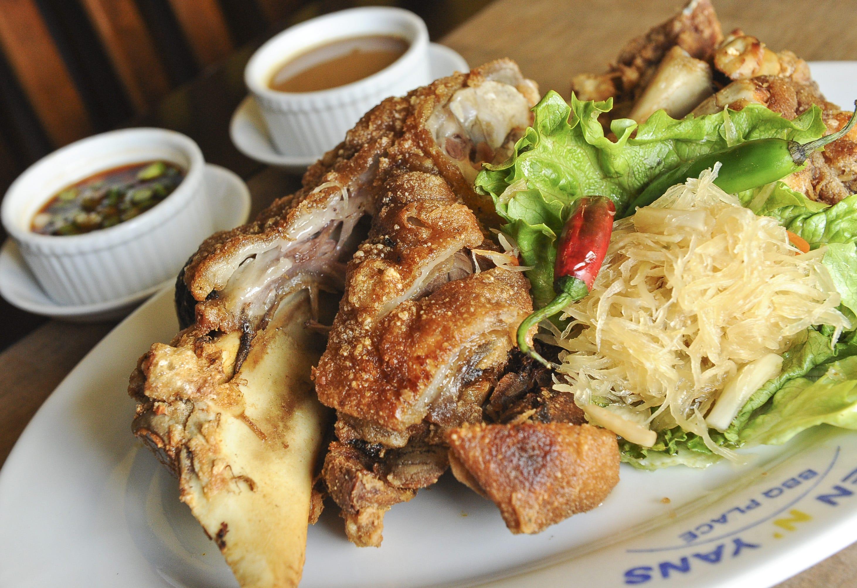 A house favorite, crispy pata, prepared at Ben n' Yan's restaurant. Crispy pata is deep-fried pork knuckles.