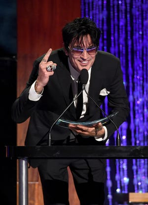 Motley Crue's Tommy Lee accepts the Skins award onstage at PETA's 35th Anniversary Party.
